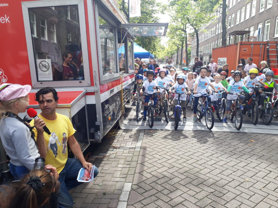 Kids enjoying a bicycle race in Amsterdam