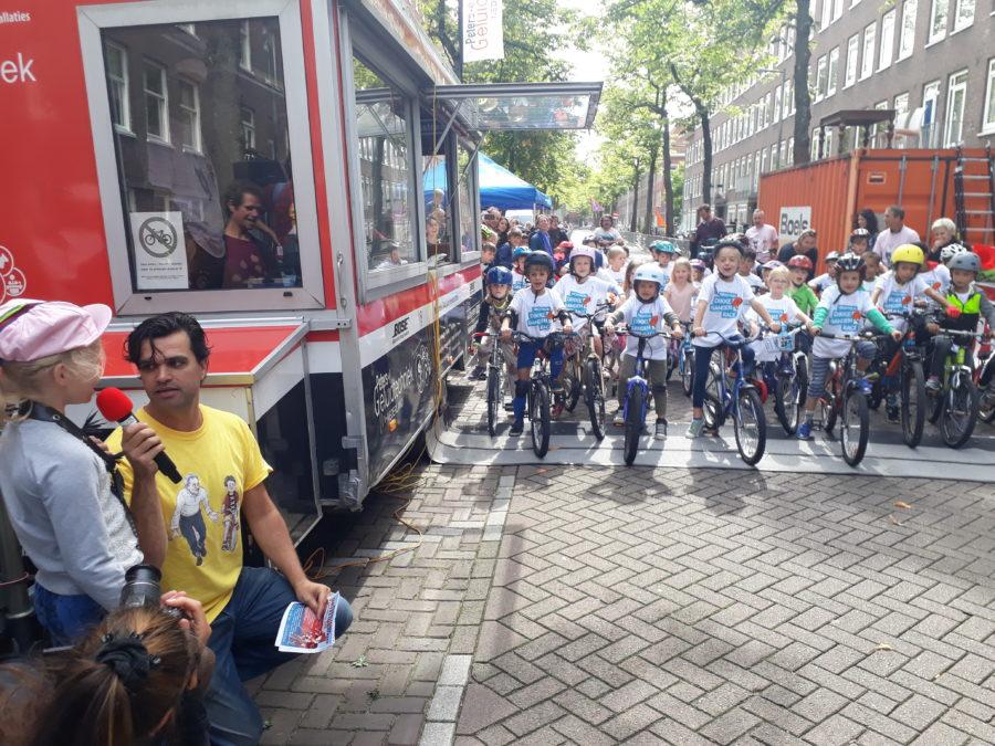 Kids enjoying a bicycle race in Amsterdam