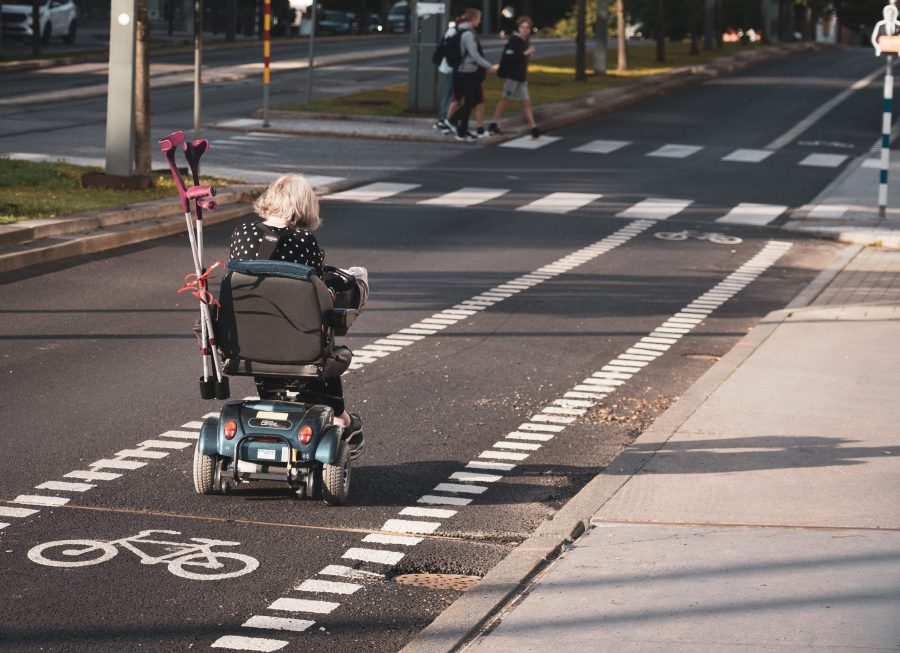 Person in a wheelchair using a bicycle lane